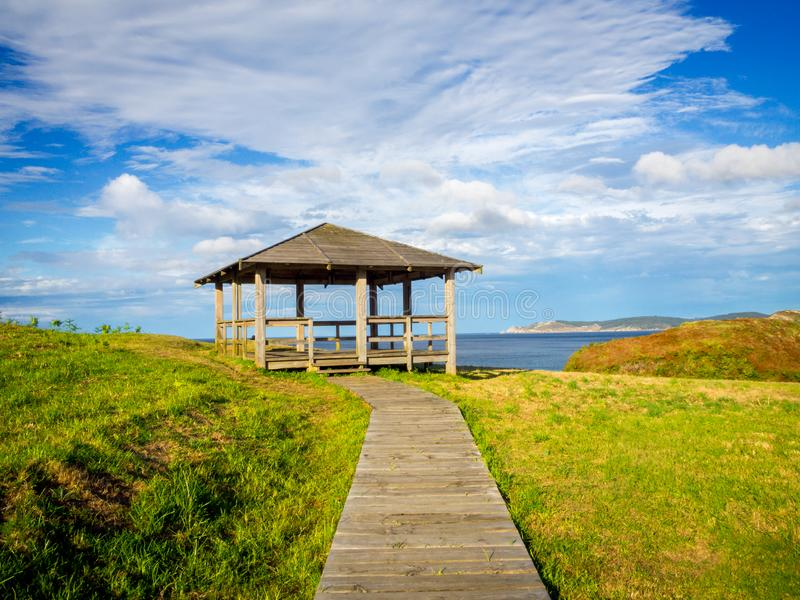 Wooden boardwalk steps leading to a lookout down to the Cantabrian sea royalty free stock photo