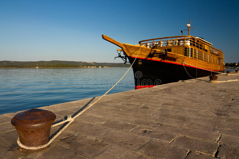Download Wooden boat stock photo. Image of nature, flag, coast - 20447788