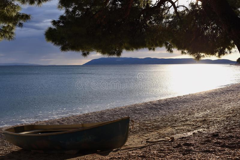Wooden boat on the Adriatic coast. stock photo