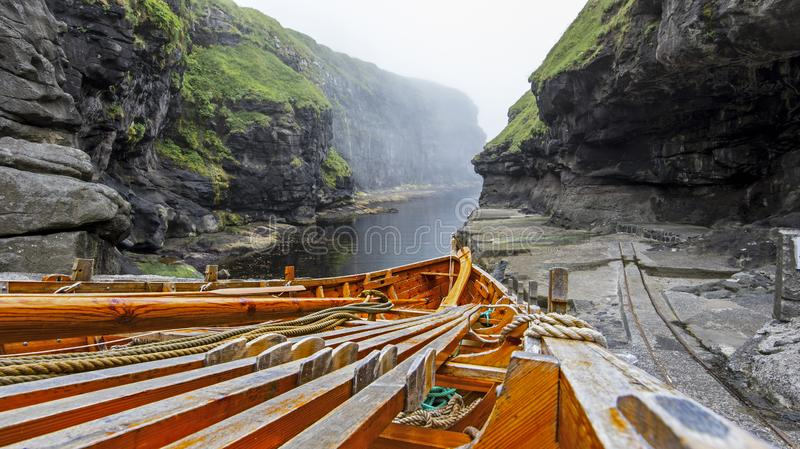 Wooden boat details in Natural gorge harbor of Gjodv village. Faroese island of Eysturoy stock images