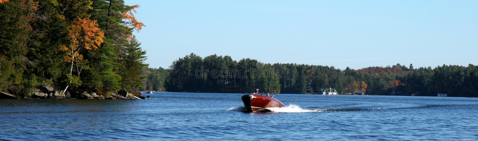 Wooden boat on a lake stock photo