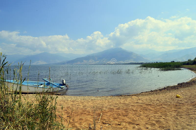 Wooden boat on a lakeshore, Large Prespa Lake in Greece royalty free stock images