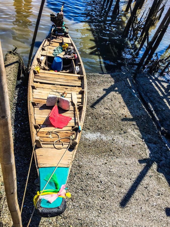 Wooden boat at low tide royalty free stock image