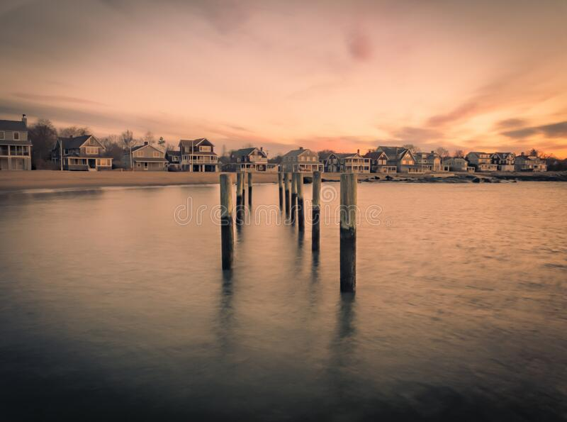 Wooden boat moorings at sunrise stock photography