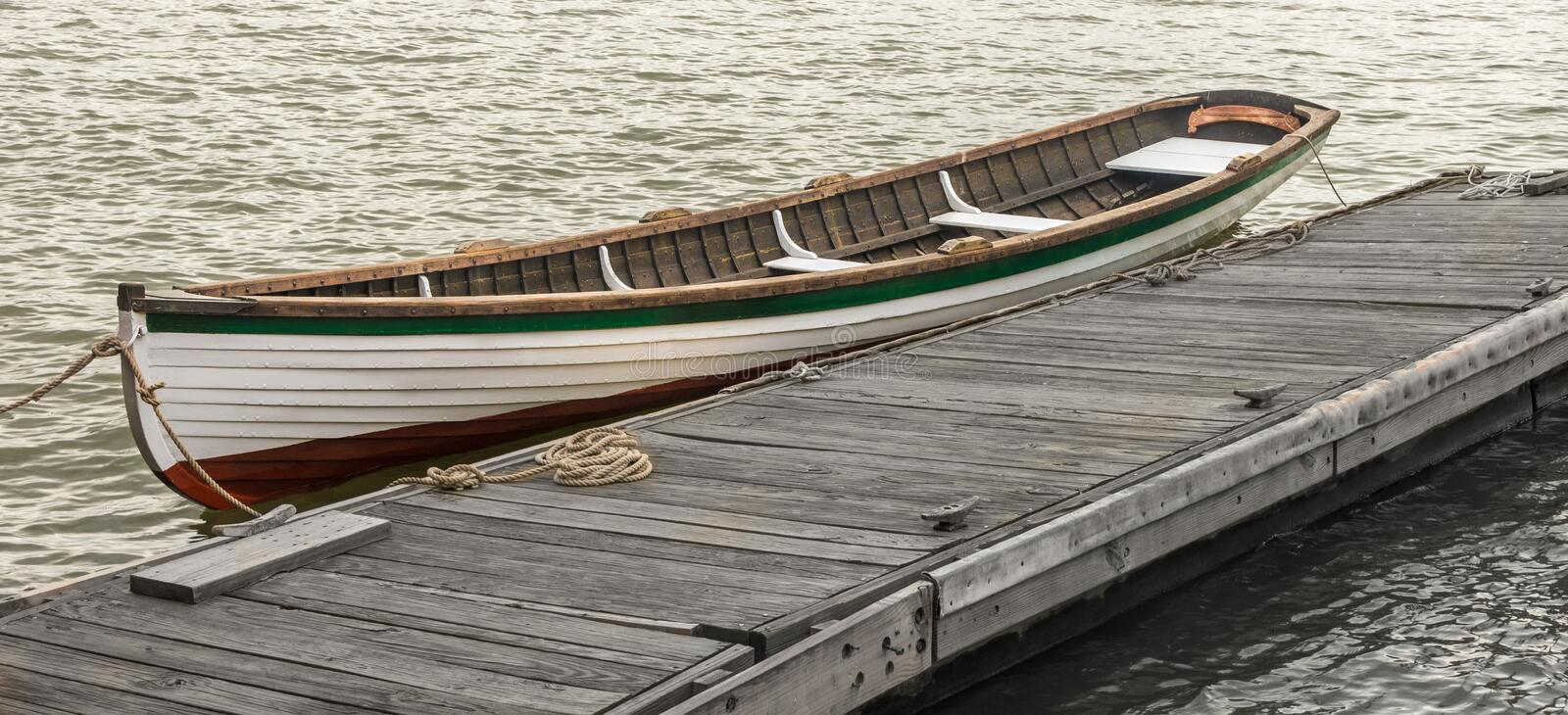 Wooden Boat at a Pier stock image