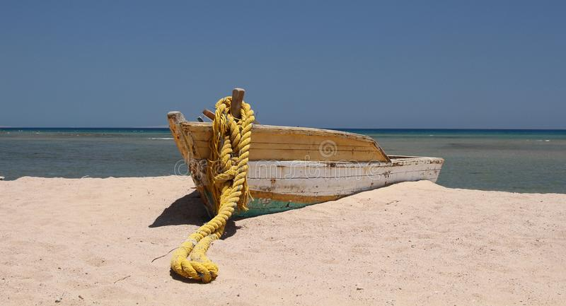 Wooden boat on sandy beach in Hurghada stock images