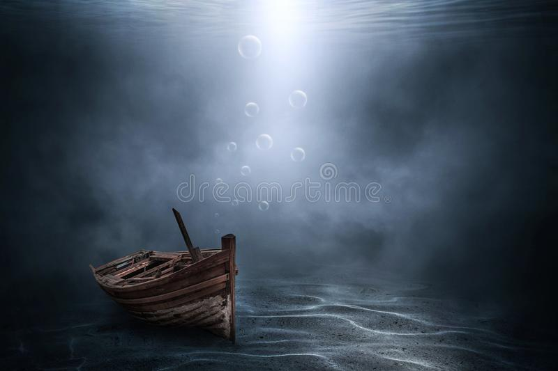 The wooden boat sank beneath royalty free stock images