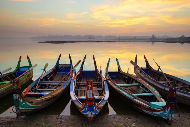 Wooden boat in Ubein Bridge at sunrise, Mandalay, Myanmar. (World longest wooden bridge royalty free stock photography