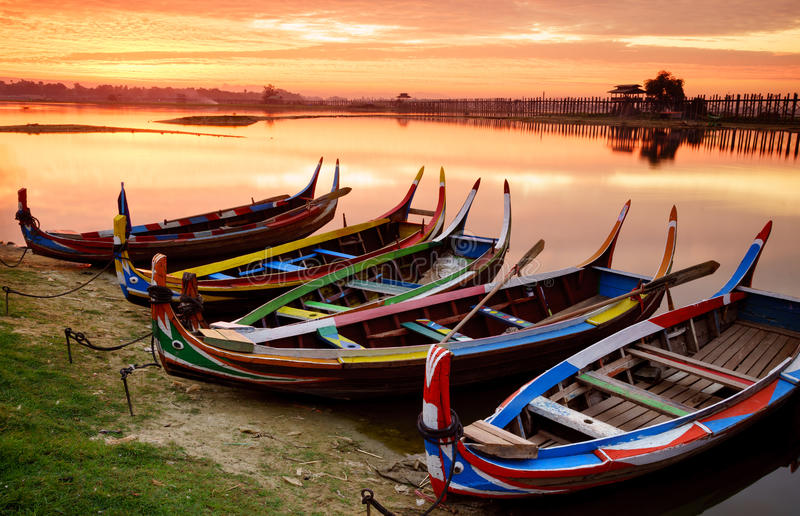 Wooden boat in Ubein Bridge at sunrise, Mandalay, Myanmar. (World longest wooden bridge stock image