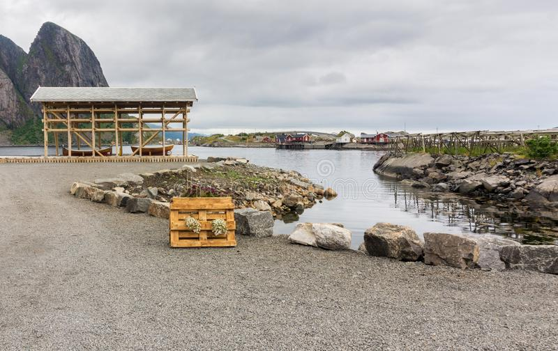 Wooden boat under an awning on the rocky shore, Lofoten archipel. Ago, Nordland county, Norway stock photo