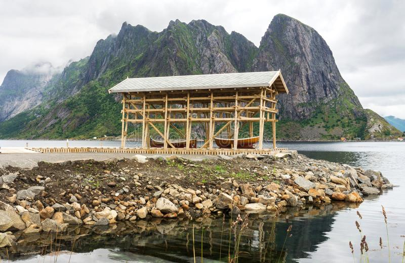 Wooden boat under an awning on the rocky shore, Lofoten archipel. Ago, Nordland county, Norway royalty free stock photo