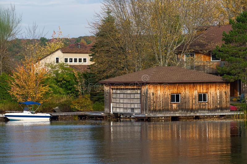 Wooden boathouse and a boat royalty free stock image