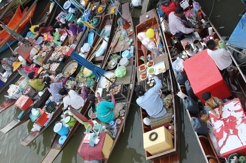 Amphawa floating market. Wooden boats busy ferrying people at Amphawa floating market on 14 january 2012 royalty free stock photography