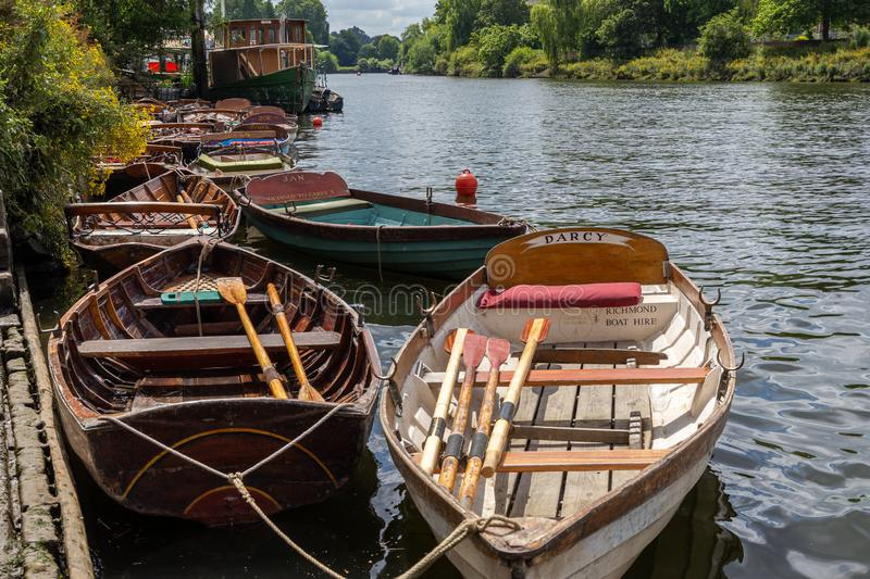 Richmond boats for hire moored on the River Thames stock photography