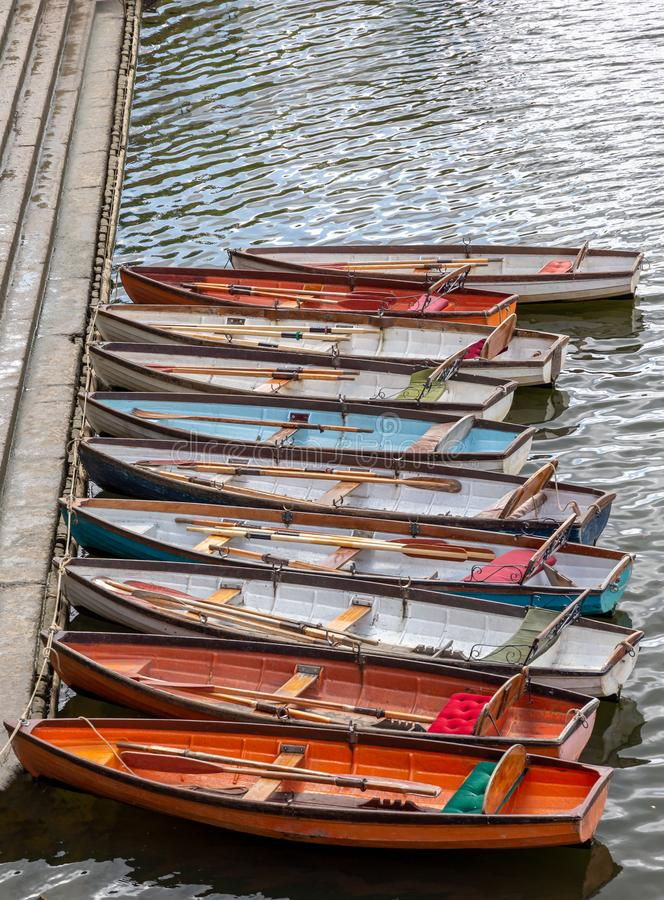 Wooden boats for hire moored on the River Thames in Richmond royalty free stock images