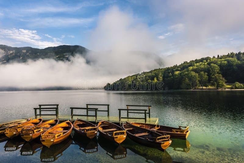 Wooden boats in Lake Bohinj, Triglav National Park, Slovenia royalty free stock images