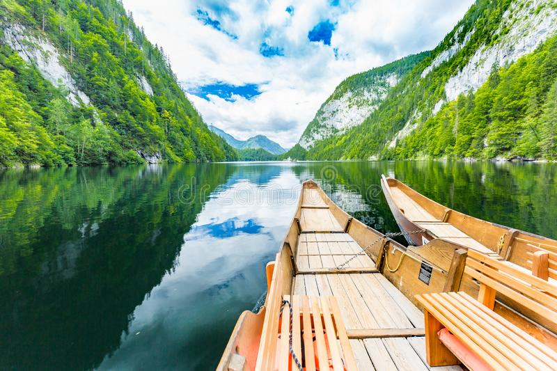 Boats in Alpine lake with crystal water in background of mountain in morning. Beautiful mountain landscape stock photo