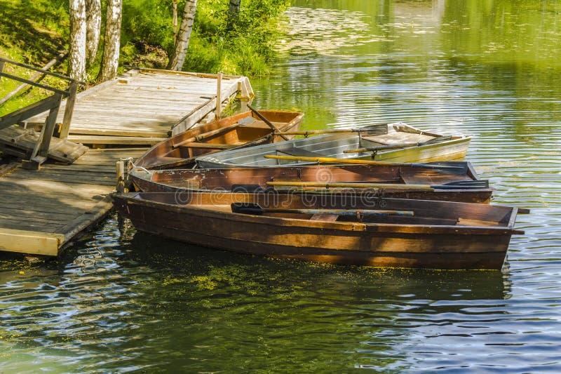 Wooden boats on the pier. Kostroma Sloboda, Russia stock photos