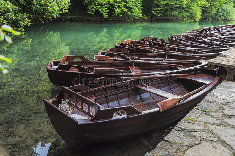Wooden boats at the pier on the lake in the evening light. Plitvice Lakes, Croatia stock image