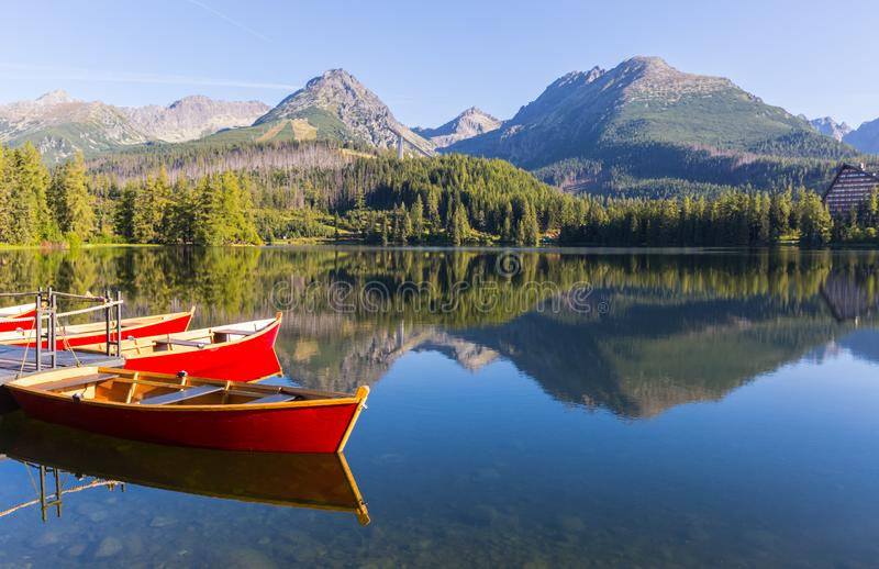 Wooden boats on the pier in a mountain lake. Tatras in Slovakia stock image