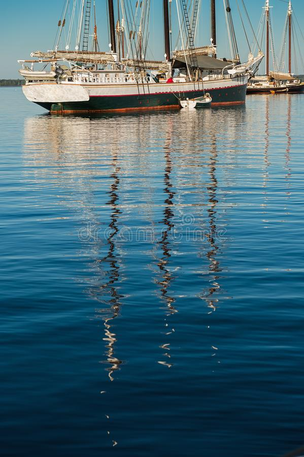 Wooden Boats Reflections Vertical royalty free stock photography