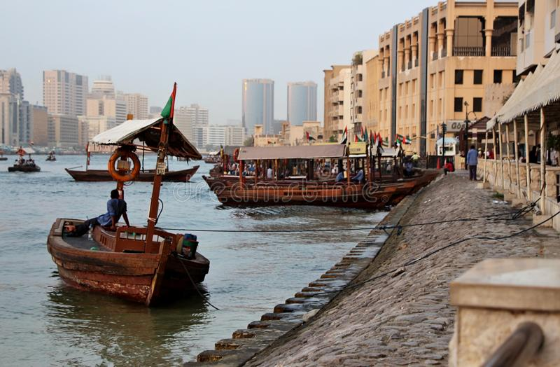 Wooden boats and ships in harbor in old Dubai City stock photos