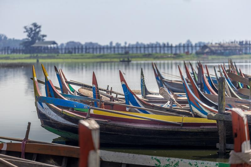 Wooden boats in Ubein Bridge. Mandalay, Myanmar World longest wooden bridge royalty free stock image