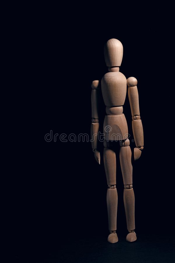 Wooden Body: Neutral. Wooden body doll expressing an emotion it humanizes. In this case the neutral stock photo