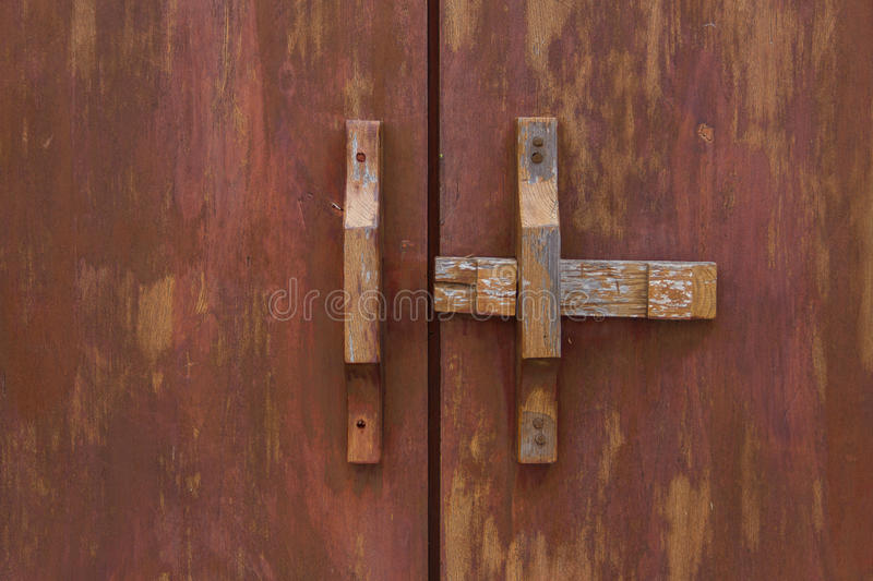 Wooden bolt at door. Wooden bolt at the door royalty free stock photography
