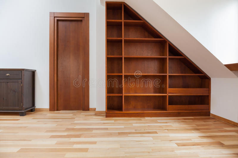 Wooden bookshelf in the attic stock images