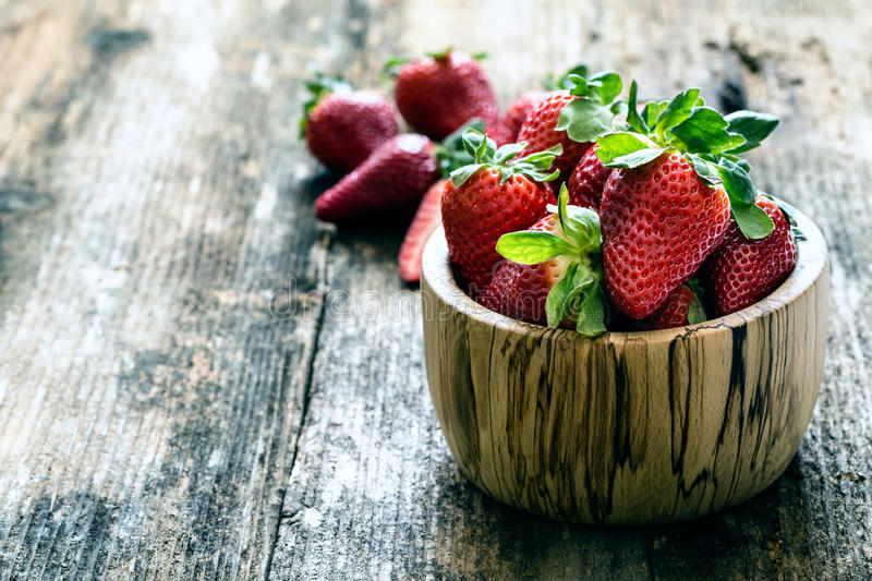 wooden bowl of fresh strawberries royalty free stock image