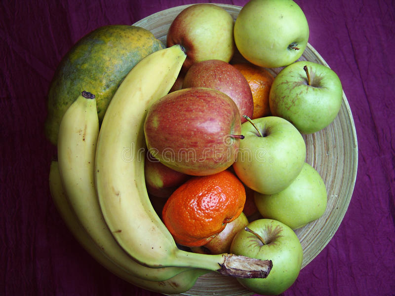 Wooden bowl with fruits royalty free stock photos