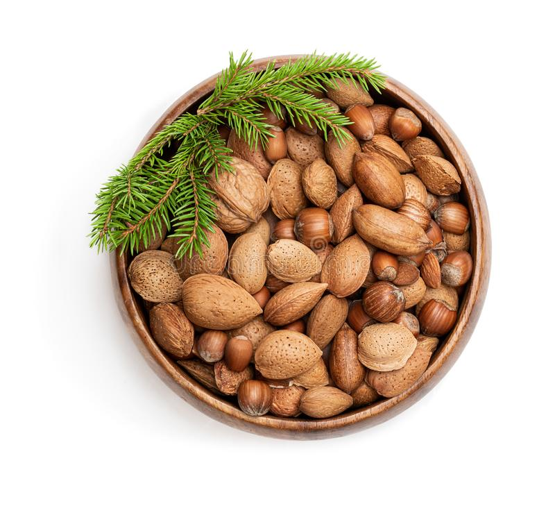Wooden bowl with mixed nuts isolated on white. Christmas set royalty free stock photos