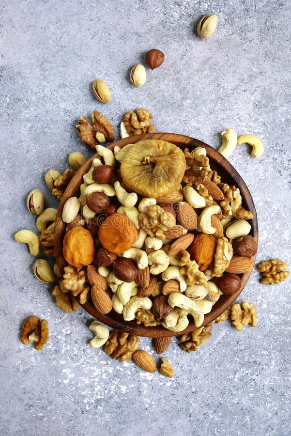 Wooden bowl with nuts pistachio, walnut, hazelnut, cashew, alm stock photos