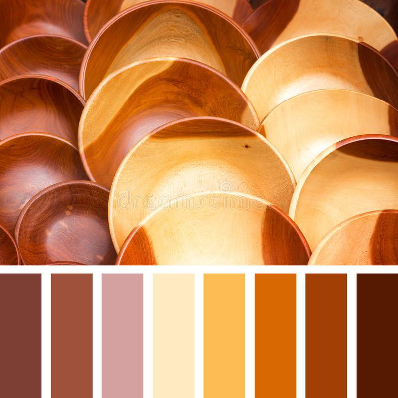 Wooden bowl palette. Carved natural wood bowls in a colour palette with complimentary colour swatches royalty free stock photos