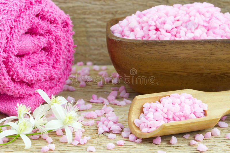 Wooden bowl and spoon filled with bath salt royalty free stock photo
