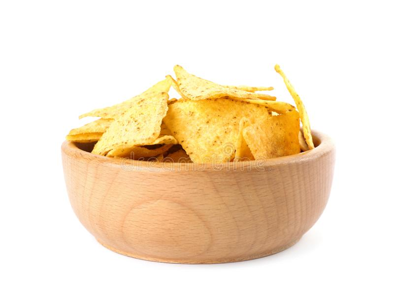 Wooden bowl with tasty Mexican  chips on white background stock photography