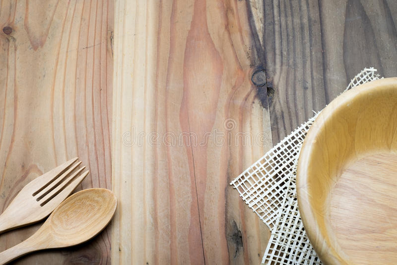 The wooden bowl on a wood table stock photography