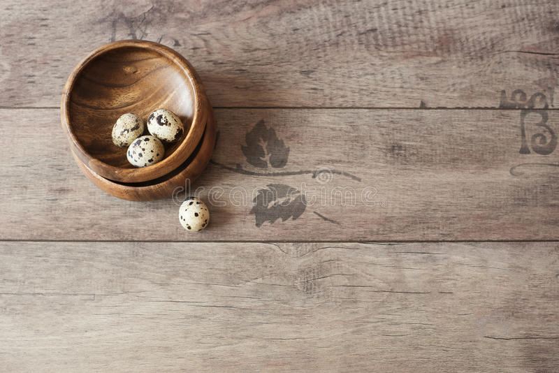 Download Wooden Bowls With Quail Eggs. Rustic Wood Background, Diffused  Natural Light. A