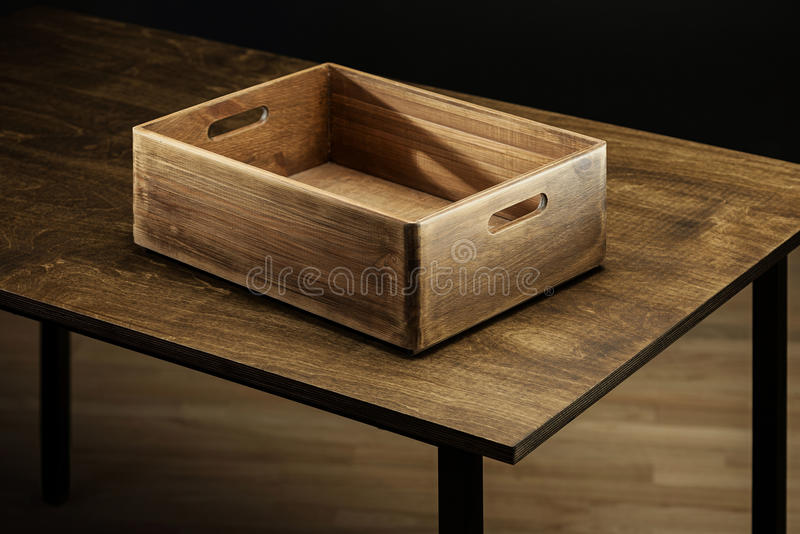 Wooden box. Empty rustic wooden box on the table royalty free stock photography