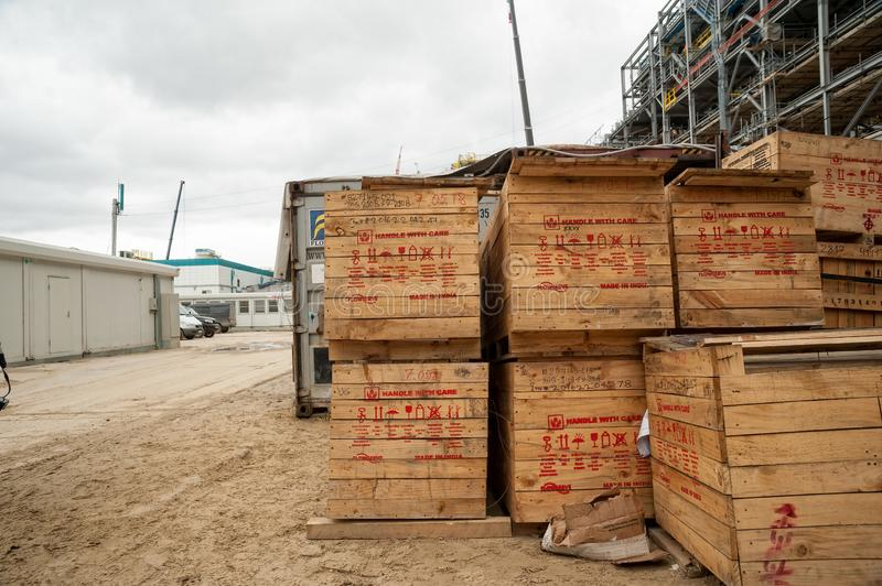 Wooden box with equipment on factory area. Tobolsk, Russia - May 29. 2018: Sibur company. Construction of plant on processing of hydrocarbons. Wooden box with royalty free stock photos