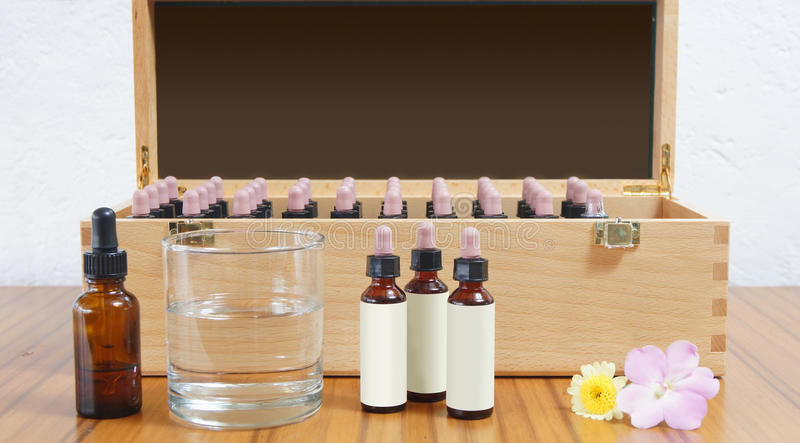 Wooden box with glass jars inside for use in flower essence therapy royalty free stock photo