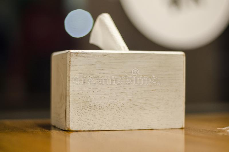 A wooden box of napkins royalty free stock photography