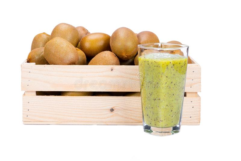 Wooden box with ripe kiwi fruits and a glass with fresh kiwi smoothie stock images