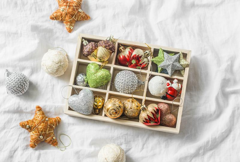 Wooden box of vintage christmas decorations on the light background, top view royalty free stock photos