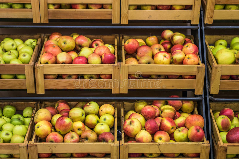Wooden boxes of apples in the supermarket royalty free stock images