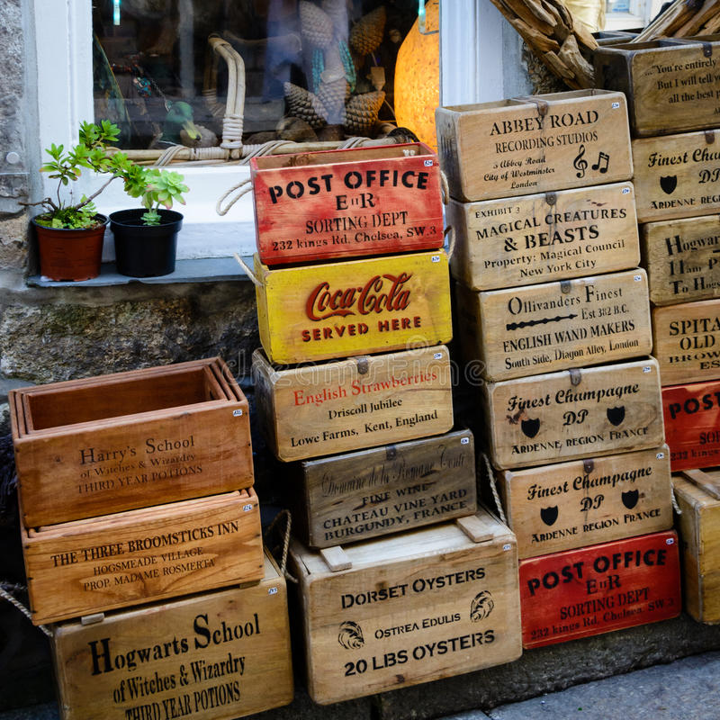 Wooden boxes - St Ives. Vintage wooden boxes are on display and for sale outside a small shop in St Ives royalty free stock images