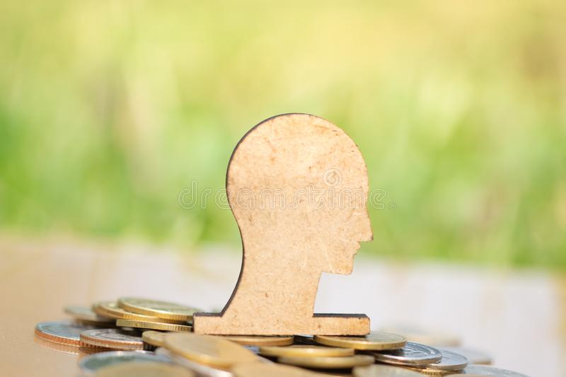 Wooden brain and stack of coins in concept of savings and money growing or energy save. Business investment growth concept,money saving. Investment concept stock photography