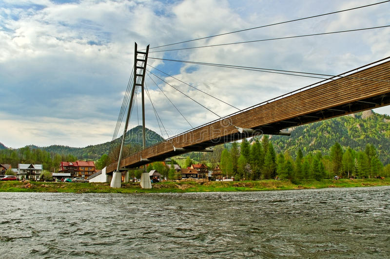 Dunajec river. Wooden bridge above Dunajec river between Slovakia and Poland royalty free stock photos