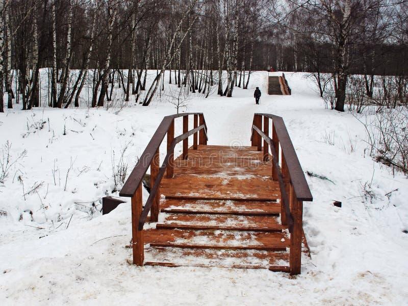 Wooden bridge across the river royalty free stock image